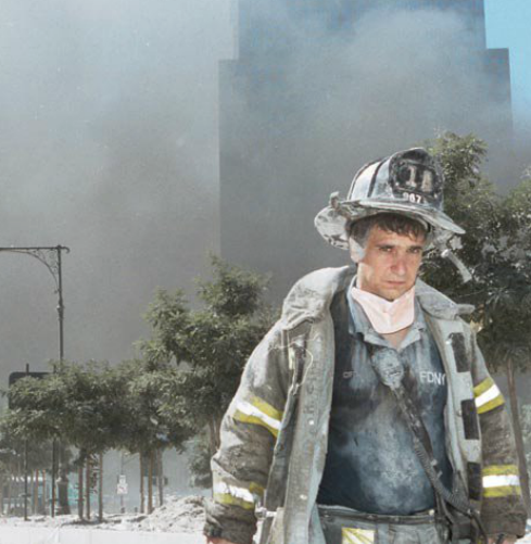A firefighter walks away from Ground Zero after the collapse of the Twin Towers.