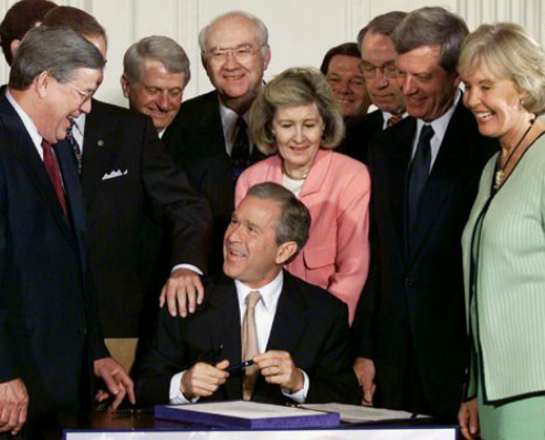 Congresswoman Dunn (r) at a 2001 White House ceremony at which President Bush signed into law a bill that lowered U.S. income taxes across the board.