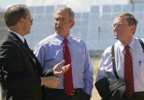 Senator Domenici and President Bush talk with Thomas Hunter of Sandia National Laboratory during a tour of the Lab's National Solar Thermal Test Facility in August 2005.