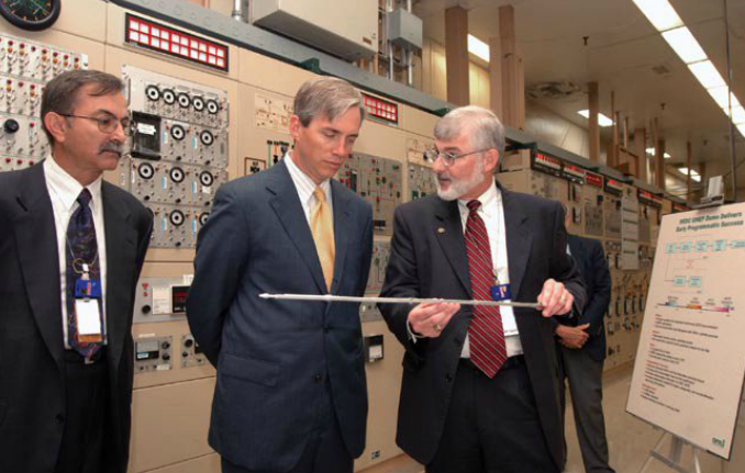 Deputy Secretary Sell (center) revives an explanation of GNEP-related nuclear energy technologies during a visit in June 2006 to the Oak Ridge National Lab's Radiochemical Engineering Development Center.