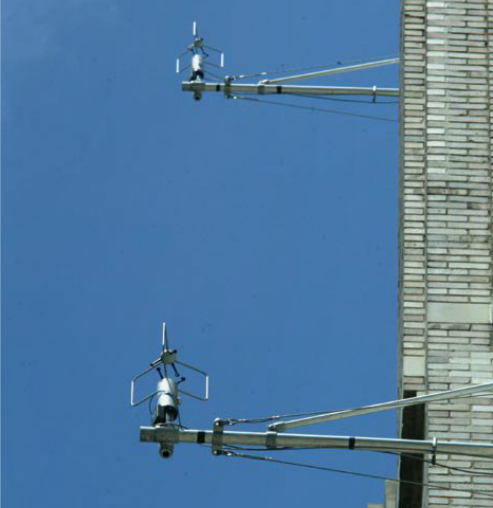 Sensors used to track biological, chemical and radiological agents sit on the side of a U.S. Post office building in New York City in June 2003.