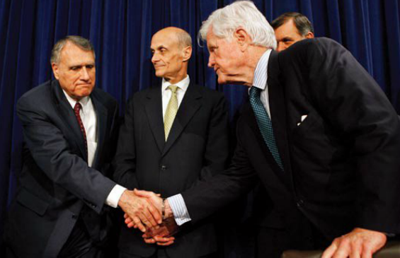 Republican Senator Jon Kyl and Democratic Senator Edward Kennedy, at a May 17 news conference announcing the bipartisan agreement on the immigration reform bill. Homeland Security Secretary Mitchael Chertoff and Senator Mel Martinez (R-FL) are in the back.